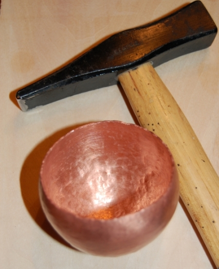 Blacksmithing Hammer used to raise copper vessel