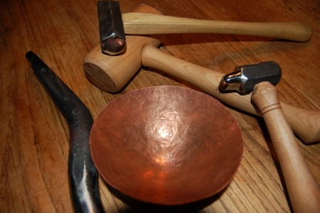 Raising hammers, stake, and hand hammered copper bowl